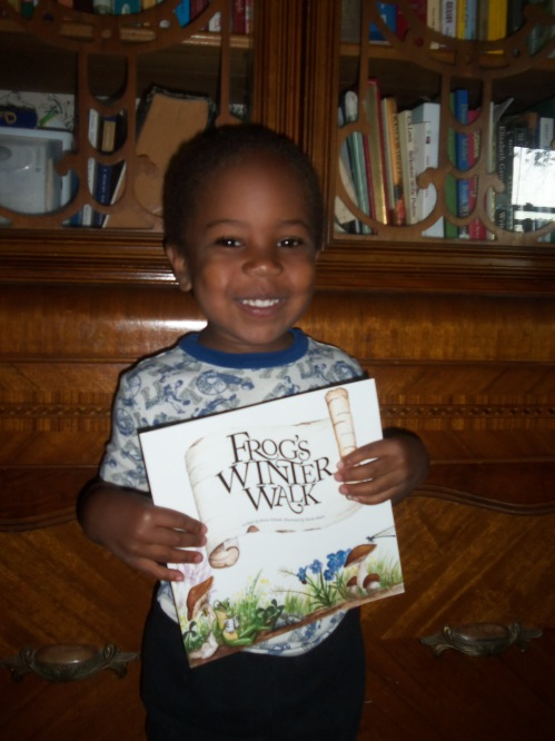My favorite 3-year-old holding my latest book